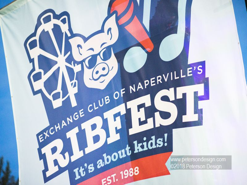 Image of Naperville's Rib Fest welcome banner sponsored by the Naperville Exchange Club